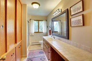 MAIN FLOOR BATH OFFERS BUILT IN LINEN CLOSETS AND CABINETS