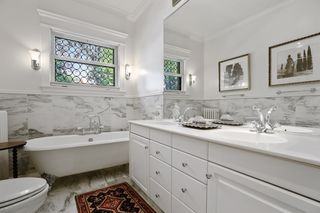 The ensuite bathroom off Bedroom 1 features marble floors & surround, claw foot tub and leaded glass window - 2nd Floor
