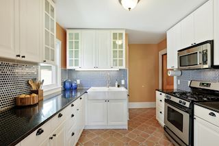 3204 47th Ave S - remodeled kitchen with farmhouse sink and tile backsplash
