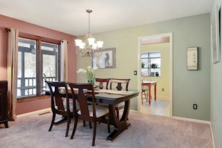 Spacious formal dining area off kitchen