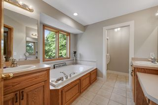 Private owners full bath with dual vanities, separate jetted tub and shower