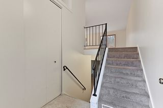Stairway to upper level with Bedroom,  Full Bath, Living Room, Dining Room and Kitchen