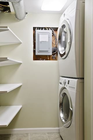 Laundry room with built in shelves to organization.