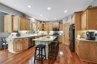 Your kitchen has new top of the line black stainless appliances and trendy tile backsplash