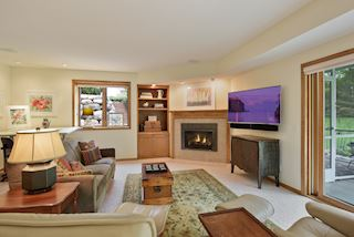 Gas Fireplace, Surround Sound and A Hint of the Screen Porch to the Right