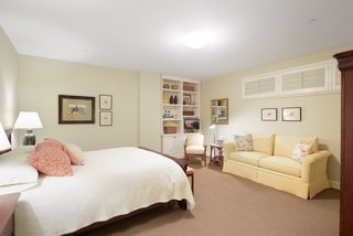 Roomy second bedroom with a built-in bookcases a huge walk-in closet and an adjoining 3/4 bath