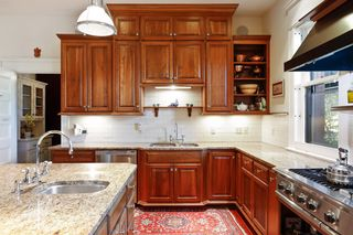 Custom Cherry cabinetry with beautiful stone countertops & subway tile - Main Level