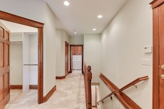 Back entry hall - walk-in closet, back staircase, powder bath and laundry