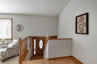 Warm & inviting entry way leads to upper main level