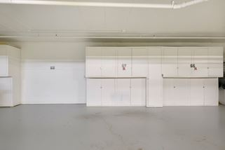 Garage 67 is owned with built-in storage units. Garage 66 is currently rented by owner for $35/month. Rental garage can be assigned to new owner.