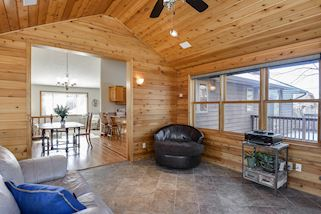 Four season porch is vaulted with knotty pine & walls of windows