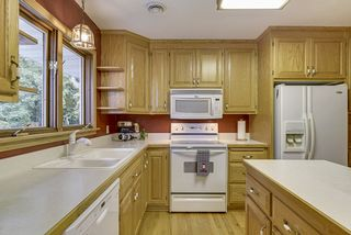 Custom oak cabinetry throughout, very functional kitchen with lots of cupboards!