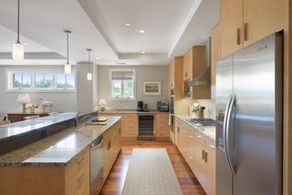 Well thought out chef's kitchen with high end appliances with Granite and Cambria counter tops.