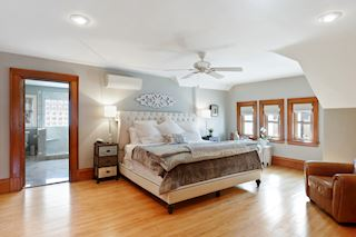Luxury master bedroom with recessed lights, ceiling fan and lots of storage.