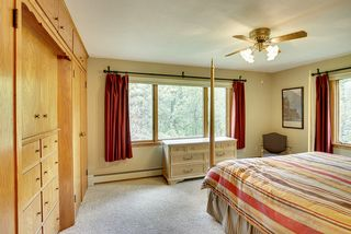 MASTER BEDROOM OVERLOOKS RIVER AND HAS CUSTOM BUILT IN DRAWERS & CLOSETS