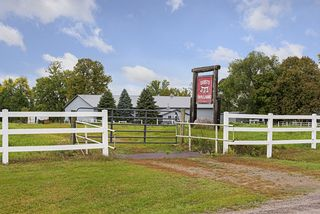 12 Acres features indoor & outdoor riding arena, outdoor riding ring and several out buildings!