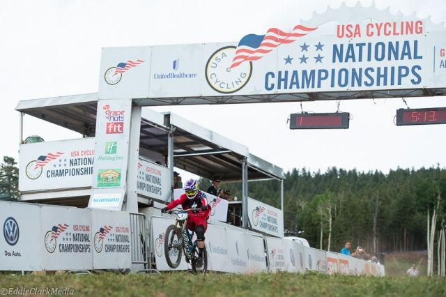 Aaron Gwin wheelies across the finish line to win the pro men's downhill