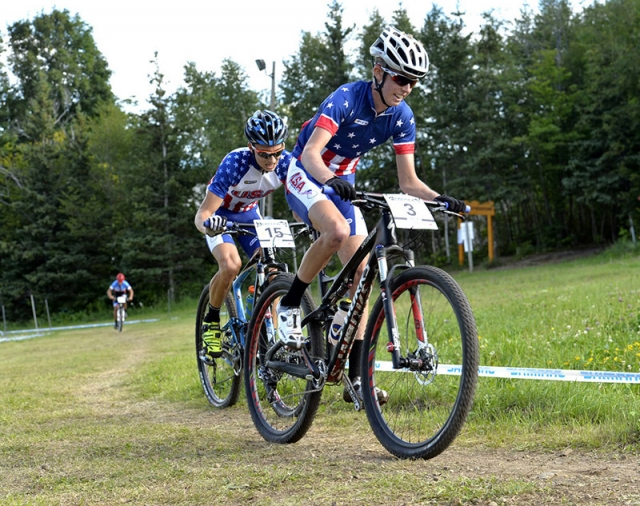Lucas Newcomb leads Neilson Powless in the junior men's XC