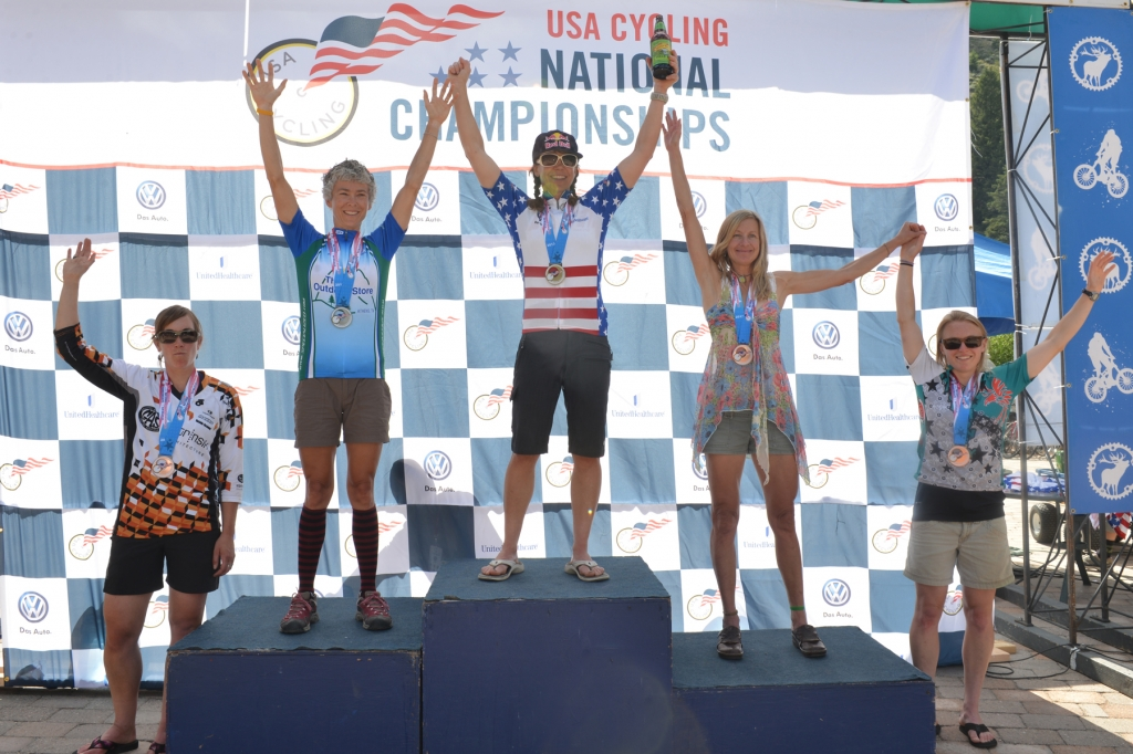 Rebecca Rusch stands atop the women's singlespeed podium