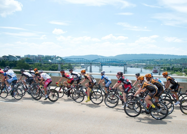The men's peloton traverses the Tennessee Bridge