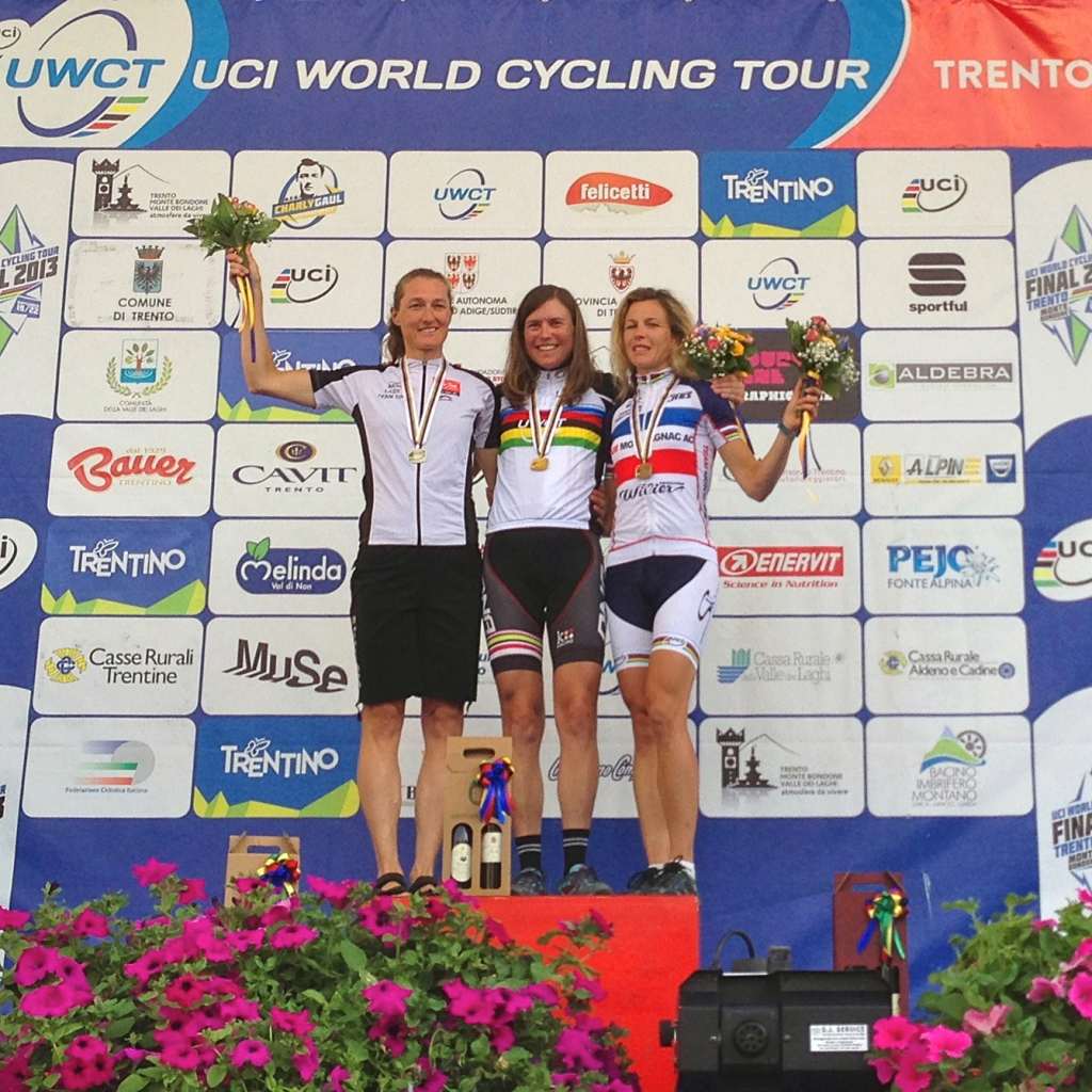 Anne Perry on the top step of the podium after winning the gold medal in the women's 40-44 road race.