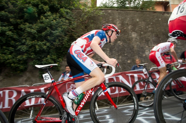Logan Owen makes a move on the climb up Via Salviati during the juniors men's road race