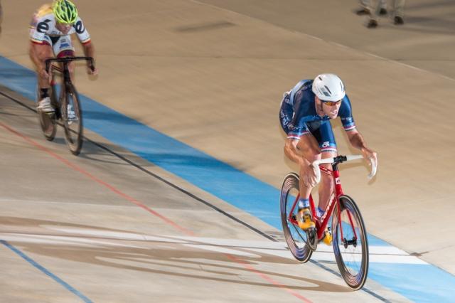 Bobby Lea kicks into a higher gear during the points race at the 2014 USA Cycling Elite Track National Championships