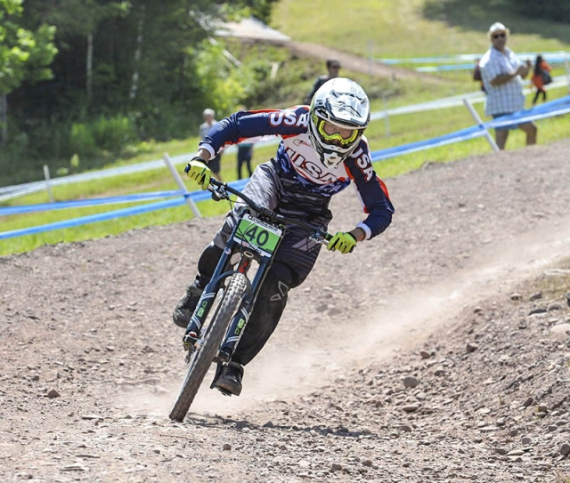 Chase Nelson on his way to a 12th-place finish in the juniors downhill at the 2014 UCI MTB World Cup in Windham, NY