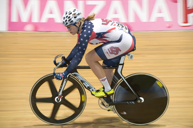 Jennifer Valente en route to her fourth-place finish in the women's scratch race at the 2014 UCI Track World Championships in Cali, Colombia