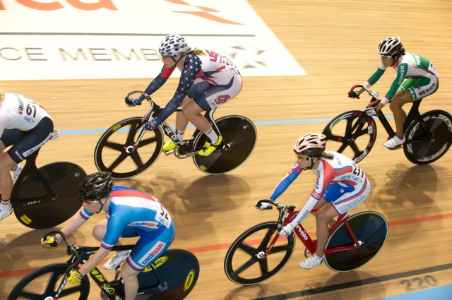Jennifer Valente rides in the pack during the women's scratch race at the 2014 UCI Track World Championships in Cali, Colombia
