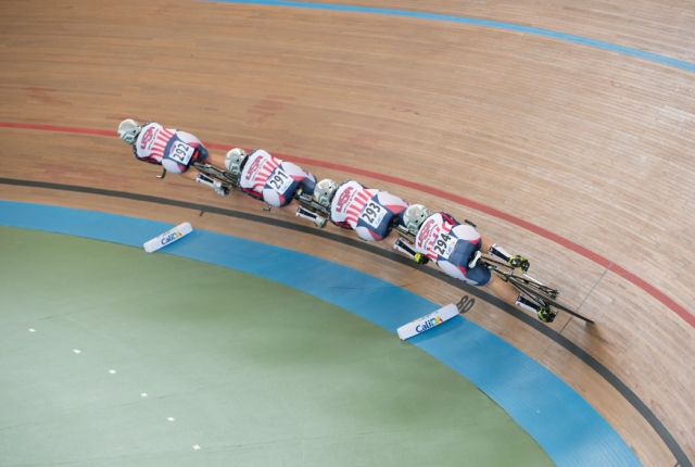 The U.S. women's pursuit team races through a turn at the 2014 UCI Track World Championships