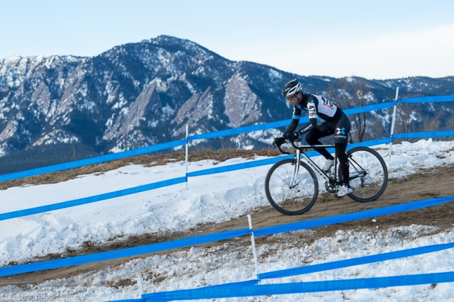 Tim Faia rides against the backdrop of the Colorado Rockies on his way to victory