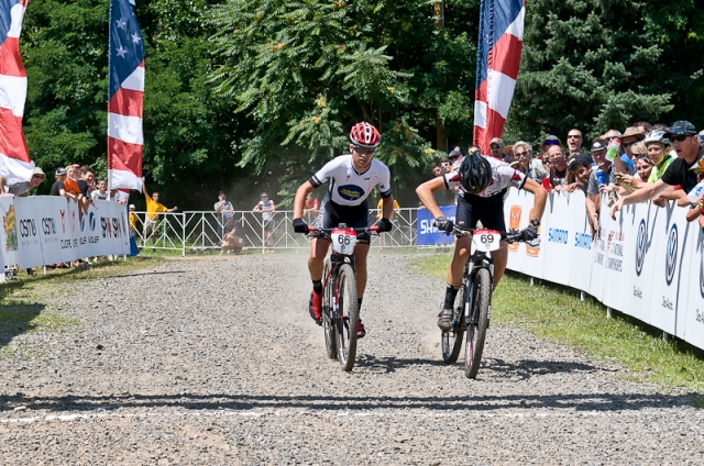 Adam Croft (r) outsprints Michael Mace in the men's 9-14 short track cross-country race.