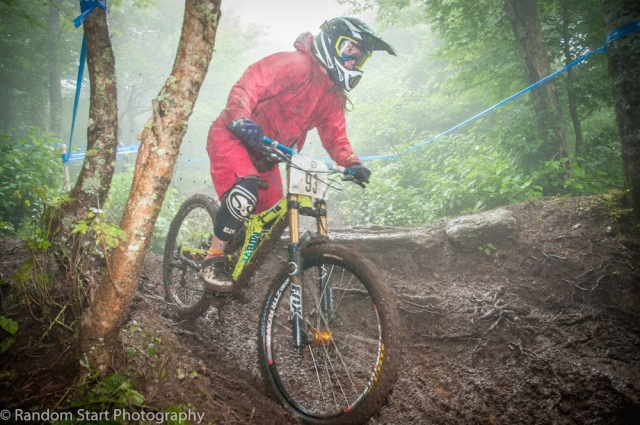 Alison Zimmer trecks through the mud toward the Beech Mountain win.