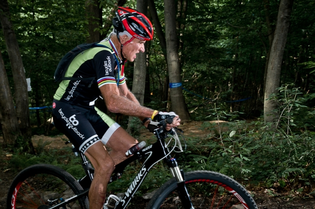 Fred Schmid rides to the men's masters 80-84 national championship.