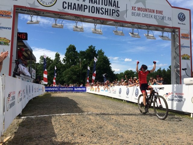 Lea Davison celebrates winning the Women's XC Pro National Championship.