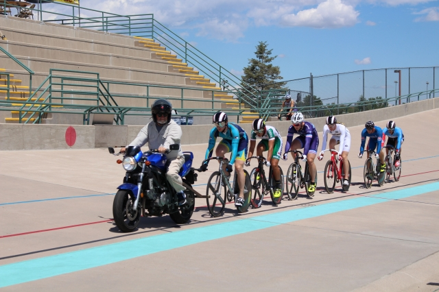 Riders follow the motorbike in the Keirin.