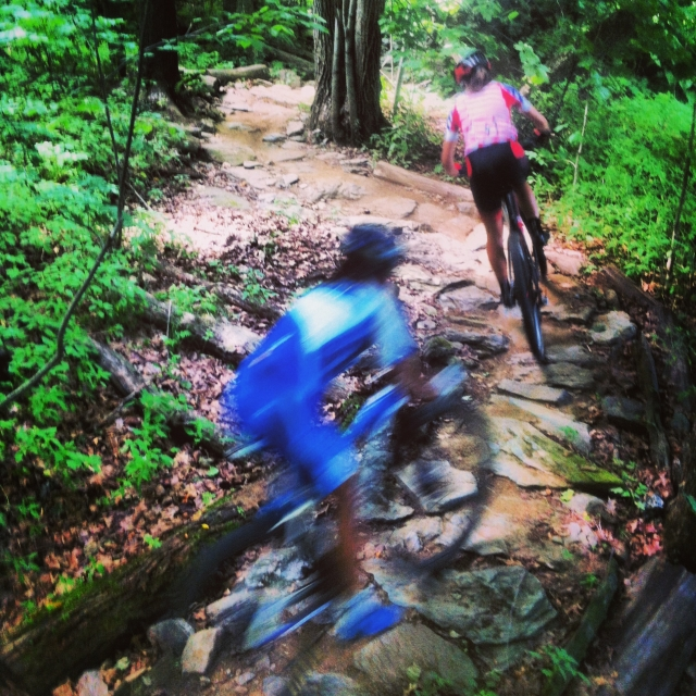Riders race through the trails in Williston, Vt.