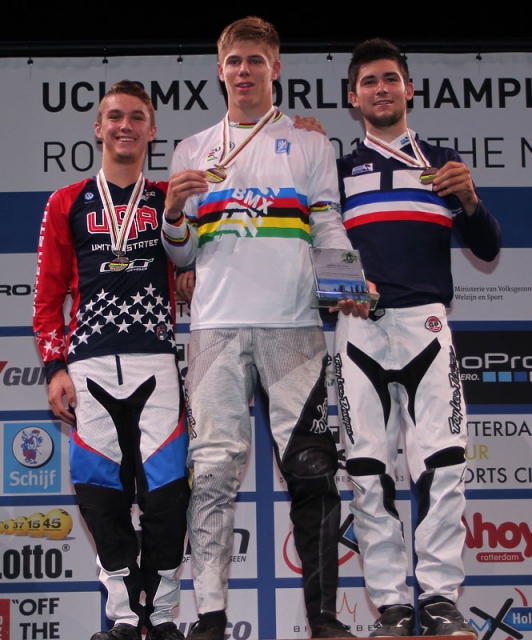 Sean Gaian on the podium with a silver medal