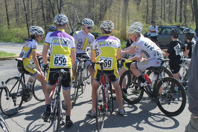 CCAP Travel Team riders huddle before the start of a race.