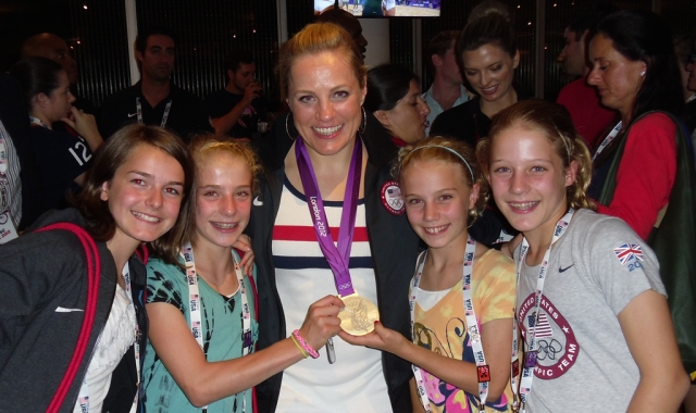 Jennie Reed poses with young fans and her Olympic medal