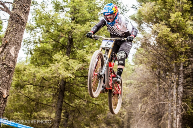 Jill Kintner gets big air en route to her 13th national mountain bike title