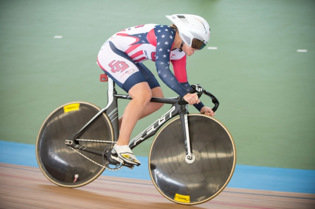 Sarah Hammer races around the track in the omnium's flying lap at the 2014 UCI Track World Championships in Cali, Colombia