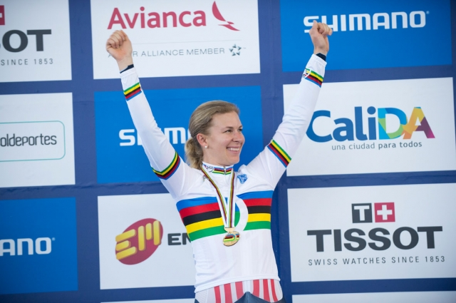 Sarah Hammer salutes the crowd after donning the rainbow jersey for winning the women's omnium at the 2014 UCI Track Cycling World Championships in Cali, Colombia