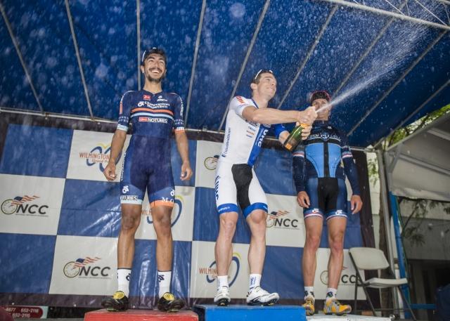 TBradley White sprays the bubbly after winning the men's race