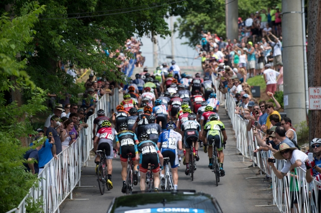 The men's peloton makes the Kent Street hill climb.