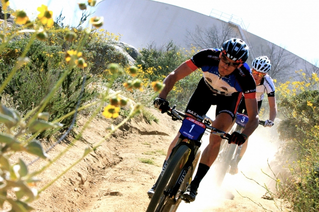Raphael Gagne leads Anton Cooper during the elite men's race at Fontana City.