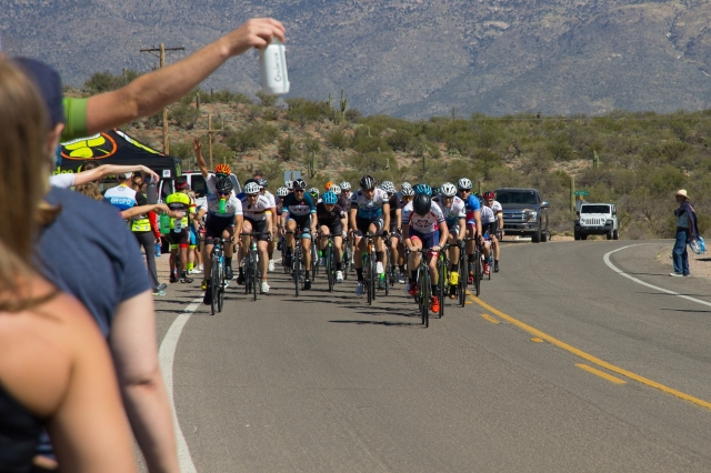 Amongst others, Men's B riders approach the feed zone on a hot Arizona course. Photo credit: Marielle Smith