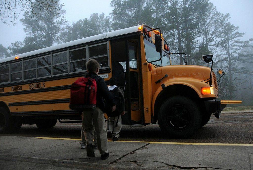 kids running to a bus