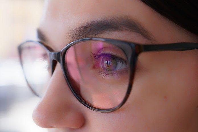 closeup of female wearing eyeglasses